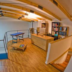 Estudios y biblioteca de estilo  por homify