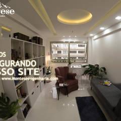 Sala comercial padrão 02 modificada: Lojas e imóveis comerciais  por Montese Engenharia