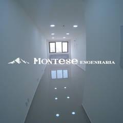 Sala comercial padrão: Lojas e imóveis comerciais  por Montese Engenharia