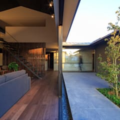 富の原の家: 川添純一郎建築設計事務所が手掛けたリビングです。