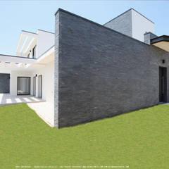 Entrada de casa com 3 quartos de arquitectura contemporânea : Casas  por OGGOstudioarchitects, unipessoal lda