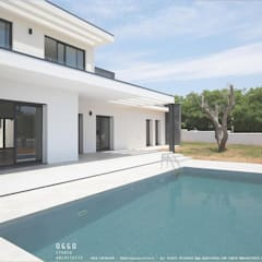 Houses by OGGOstudioarchitects, unipessoal lda
