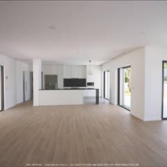 Interior de moradia T3 no Algarve: Cozinhas  por OGGOstudioarchitects, unipessoal lda