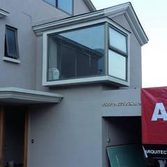 CASA   ESTEVEZ: Casas unifamiliares de estilo  por AOG