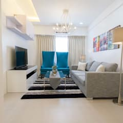 One Orchard Road:  Living room by TG Designing Corner