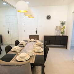 One Orchard Road:  Dining room by TG Designing Corner