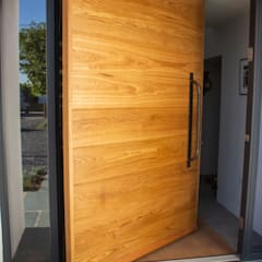 ​Timber Pivot Door made at our joinery in Wadebridge:  Wooden doors by Camel Glass