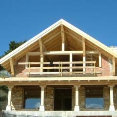 Acabados en madera : Casas rurales de estilo  de Manuel Monroy, arquitecto