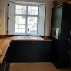 hidden microwave in large larder cupboard:  Built-in kitchens by Jim Sharples Furniture
