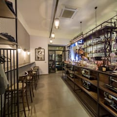 Drink bar La Sartoria: Bar & Club in stile  di Studio MetroQuadro