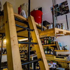 "Coffee bistrot ""Aret a'chies"": Bar & Club in stile  di Studio MetroQuadro"
