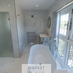 LOFT CONVERSION HOUSE EXTENSION AND FULL HOUSE REFURB IN BEACONSFIELD:  Bathroom by The Market Design & Build