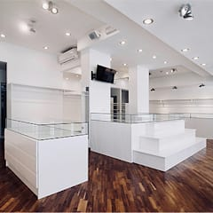 Lara - Boutique: Negozi & Locali commerciali in stile  di nicola castellano | designer