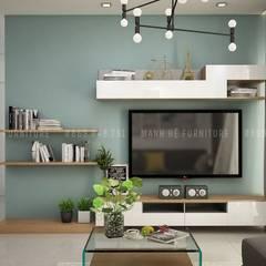 Để tiết kiệm diện tích cho căn phòng, anh Hưng đã yêu cầu lắp ti vi lên vách tường:  Phòng khách by Công ty TNHH Nội Thất Mạnh Hệ