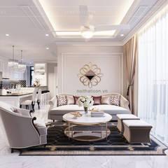 Thiết kế căn hộ Landmark 2 Vinhomes Central Park - Phong cách Tân Cổ Điển:  Phòng khách by ICON INTERIOR