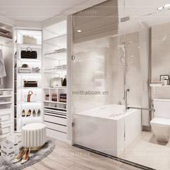 Thiết kế căn hộ Landmark 2 Vinhomes Central Park - Phong cách Tân Cổ Điển:  Phòng thay đồ by ICON INTERIOR