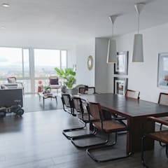 comedor apto calle 78: Comedores de estilo moderno por am Arquitectos