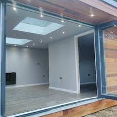 Garden room with twin skylights:  Study/office by apodo designs