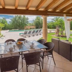 Terraza cubierta: Terrazas de estilo  de Diego Cuttone - Arquitecto