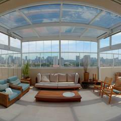 Cobertura retrátil em vidro e alumínio: Edifícios comerciais  por Imagem Vidros Decor