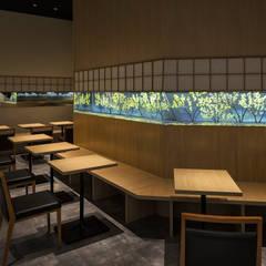 nana's green tea イオンモール岡山店: 株式会社KAMITOPEN一級建築士事務所が手掛けたレストランです。