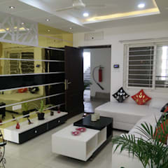 modern Living room by Enrich Interiors & Decors
