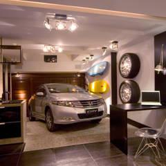 Interior: Garagens e edículas  por Studiopar Arquitetura
