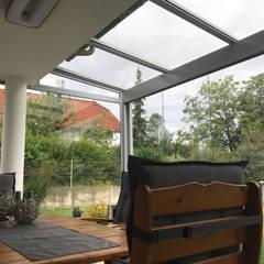 Sommergarten zum Wohlfühlen und Energie tanken:  Wintergarten von Schmidinger Wintergärten, Fenster & Verglasungen