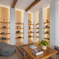 : Ruang Keluarga oleh INERRE Interior,