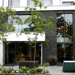 West Heath:  Front garden by IQ Glass UK