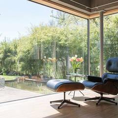 Einfamilienhaus Kleintobel:  Wintergarten von Architekturbüro Fasulo