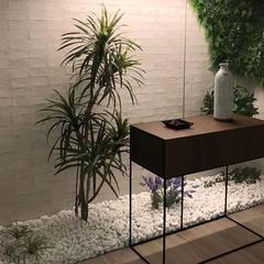 ArDecoprojects: Tres formatos cerámicos en una vivienda de Villarreal Jardines de invierno de estilo minimalista de Decocer Minimalista Cerámico