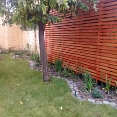 Jardines con piedras de estilo  por Melany Neuburg Ecologa Paisajista
