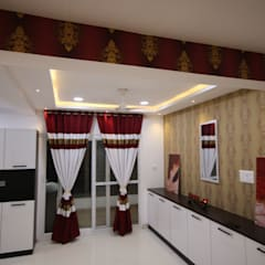 Dining Room:  Dining room by Enrich Interiors & Decors