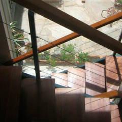 Vivienda en Alberdi Bianchi _ Andorni de Metamorfosis arquitectura y diseño Moderno Madera Acabado en madera