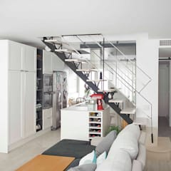 Salón con entrada abierta en la cocina: Salones de estilo  de CISOYER