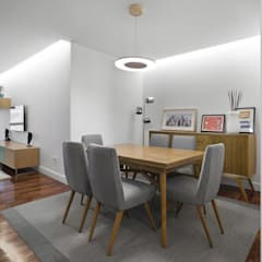 Piso Icía: Salones de estilo  de LIQE arquitectura