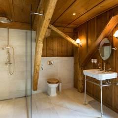 Badezimmer im Chaletstil :  Badezimmer von Traditional Bathrooms GmbH