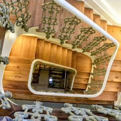 Rehabilitacion de casa en Comillas: Villas de estilo  de HIGUERA ARQUITECTOS