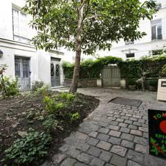 Appartement - Paris 6è - Atelier Florent: Jardin de style  par ATELIER FLORENT - Architectes d'Intérieur Paris, Minimaliste Pierre