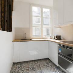 Cuisine: Cuisine intégrée de style  par ATELIER FLORENT - Architectes d'Intérieur Paris