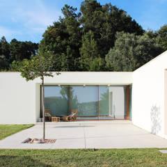 casa coli: Casas unifamilares  por Qiarq . arquitectura+design