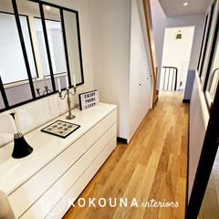 Rénovation d'un couloir: Couloir et hall d'entrée de style  par KOKOUNA