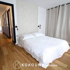 Rénovation totale d'une maison de ville de trois étages: Chambre de style  par KOKOUNA