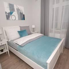 Apartament Miodowa: styl , w kategorii Sypialnia zaprojektowany przez Mleczko architektura