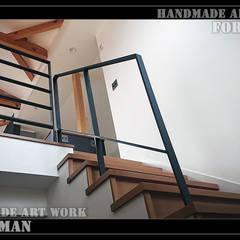 特注ロートアイアン階段手摺: 株式会社ディオが手掛けた階段です。
