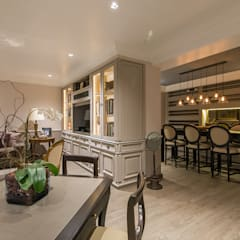 Wine cellar by KRESCH MORENO INTERIORES