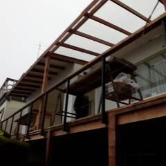 Ampliación y terraza: Casas unifamiliares de estilo  por Lares Arquitectura