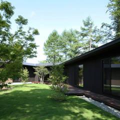 Condominios de estilo  por Studio tanpopo-gumi 一級建築士事務所, Moderno Madera Acabado en madera