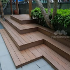 Jardines en la fachada de estilo  por 新綠境實業有限公司